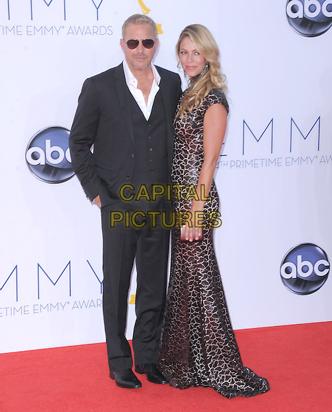 Kevin Costner and Christine Baumgartner.The 64th Anual Primetime Emmy Awards held at Nokia Theatre L.A. Live in Los Angeles, California, USA..September 23rd, 2012   .emmys full length dress black suit waistcoat white shirt brown sunglasses shades married husband wife.CAP/DVS.©DVS/Capital Pictures.
