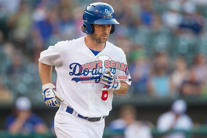 Oklahoma City Dodgers third baseman Charlie Culberson (6) heads to first base after being walked in a game against the Omaha Storm Chasers at Chickasaw Bricktown Ballpark on June 16, 2016 in Oklahoma City, Oklahoma. Oklahoma City defeated Omaha 5-4  (William Purnell/Four Seam Images)