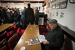 Gretna 0 Dalbeattie Star 0, 11/03/2016. Raydale Park, Lowland League. A 'groundhopper'  reading his match programme in the social club at Raydale Park, before Gretna take on Dalbeattie Star in a Scottish Lowland League fixture which ended 0-0. The match was one of six arranged by the league and GroundhopUK over the weekend to accommodate groundhoppers, fans who attempt to visit as many football venues as possible. Around 100 fans in two coaches from England participated in the 2016 Lowland League Groundhop and they were joined by other individuals from across the UK which helped boost crowds at the six featured matches. Photo by Colin McPherson.