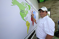 Shane Lowry (IRL) signs the world map after finishing his round during Sunday's Final Round of the rain shortened 2011 Barclays Singapore Open, Singapore, 13th November 2011 (Photo Eoin Clarke/www.golffile.ie)