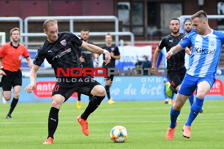 28.06.2020, Hänsch-Arena, Meppen, GER, 3.FBL, SV Meppen vs. FC Ingolstadt 04 <br /> <br /> im Bild<br /> Maximilian Beister (FC Ingolstadt 04, 10) und Marco Komenda (SV Meppen, 6) im Zweikampf, Duell, Laufduell.<br /> <br /> DFL REGULATIONS PROHIBIT ANY USE OF PHOTOGRAPHS AS IMAGE SEQUENCES AND/OR QUASI-VIDEO<br /> <br /> Foto © nordphoto / Paetzel