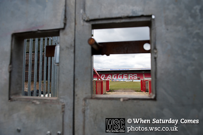 Dagenham and Redbridge 1 Burton Albion 3, 21/02/2015. Victoria Road, League Two. A view of the stadium from a locked gate. Burton Albion moved to the top of League Two following a hard-fought win over Dagenham & Redbridge played in-front of 1,718 supporters. Photo by Simon Gill.
