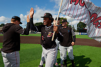 Batavia Muckdogs Ronal Reynoso (2) and Andrew Miller (right) high five teammates after clinching the Pinckney Division Title during a NY-Penn League game against the Auburn Doubledays on September 2, 2019 at Falcon Park in Auburn, New York.  Batavia defeated Auburn 7-0 to clinch the Pinckney Division Title.  (Mike Janes/Four Seam Images)