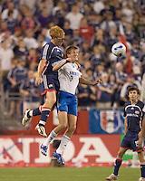 New England Revolution (13) Jeff Larentowicz and Kansas City Wizards midfielder (9) Sasha Victorine battle for a head ball. New England Revolution defeated the Kansas City Wizards, 2-0, at Gillette Stadium, Foxboro, MA on August 2, 2007.