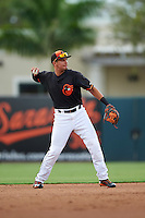 GCL Orioles second baseman Alejandro Juvier (16) throws to first during the first game of a doubleheader against the GCL Rays on August 1, 2015 at the Ed Smith Stadium in Sarasota, Florida.  GCL Orioles defeated the GCL Rays 2-0.  (Mike Janes/Four Seam Images)