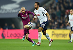 David Silva of Manchester City is challenged by Mousa Dembele of Tottenham Hotspur during the premier league match at the Wembley Stadium, London. Picture date 14th April 2018. Picture credit should read: Robin Parker/Sportimage