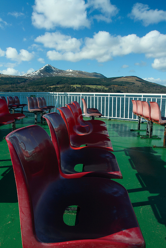 Goat Fell and red seats on the Caledonian MacBrayne Ardrossan to Brodick Arran Ferry approaching Brodick, Isle of Arran, Ayrshire<br /> <br /> Copyright www.scottishhorizons.co.uk/Keith Fergus 2011 All Rights Reserved