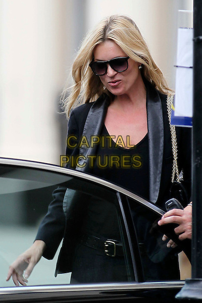Kate Moss.Spotted in Central London, England..June 27th, 2011.half length black car top jacket blazer sunglasses shades.CAP/HIL.©John Hillcoat/Capital Pictures .