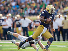Aug. 30, 2014; Everett Golson (5) runs for a touchdown as Rice Owls defensive end Brian Nordstrom (47) attempts to tackle in the second quarter..Photo by Matt Cashore