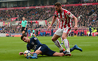 Dele Alli of Tottenham is fouled by Erik Peiters of Stoke during the EPL - Premier League match between Chelsea and West Ham United at Stamford Bridge, London, England on 8 April 2018. Photo by PRiME Media Images.