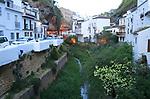 Whitewashed houses in steep river valley, Setenil de las Bodegas, Cadiz province, Spain