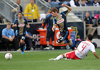 CHESTER, PA - OCTOBER 27, 2012:  Antoine Hoppenot (29) of the Philadelphia Union slips by a tackle by  Rafa Marquez (4) of the New York Red Bulls during an MLS match at PPL Park in Chester, PA. on October 27. Red Bulls won 3-0.