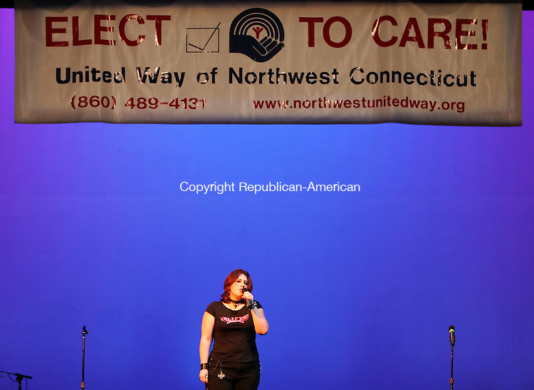 TORRINGTON; CT; 23 SEPTEMBER 2006; 092306BZ11- Catherine McKenna performs &quot;Bring Me To Life&quot; by Evanescence during the United Way of Northwest Connecticut's &quot;Sing Your Heart Out 4&quot; karaoke competition at the Warner Theatre in Torrington Saturday night.  <br />  Jamison C. Bazinet Republican-American