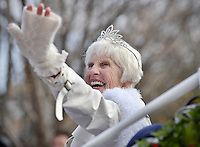 STAFF PHOTO BEN GOFF  @NWABenGoff -- 12/13/14 Grand Marshall Mary Baggett waves from a carriage during the Bentonville Christmas parade through downtown on Saturday Dec. 13, 2014.