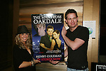 Terri Colombino and Trent Dawson (host) wth Man of Oakdale poster at Martinis w/Henry for fans wth hors d'oeuvres, autographs, photos, chatting, door gifts on April 18, 2009 at Latitude, New York City, NYC. (Photo by Sue Coflin/Max Photo)