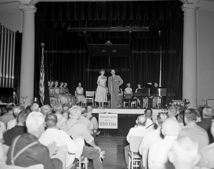 Large format black and white film negatives have been digitized by Mueller Images in Seatte, WA. Photos show participants in a parade and pageant for Miss South Dakota in 1953.