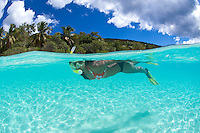 Split level view of snorkeler<br /> Honeymoon Beach.<br /> Virgin islands National Park.St John