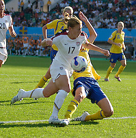 U.S. midfielder (17) Lori Chalupny is fouled by Sweden defender (3) Stina Segerstrom resulting in a penalty kick and the first goal for the U.S. The United States (USA) defeated Sweden (SWE) 2-0 during a FIFA Women's World Cup China 2007 opening round Group B match at Chengdu Sports Center Stadium, Chengdu, China, on September 14, 2007.