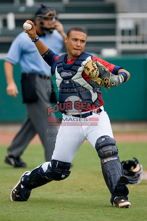 Catcher Elvin Soto #20 of Team Red makes a throw to first base against Team Blue during the USA 18U National Team Trials at the USA Baseball National Training Center on July 1, 2010, in Cary, North Carolina.  Photo by Brian Westerholt / Four Seam Images