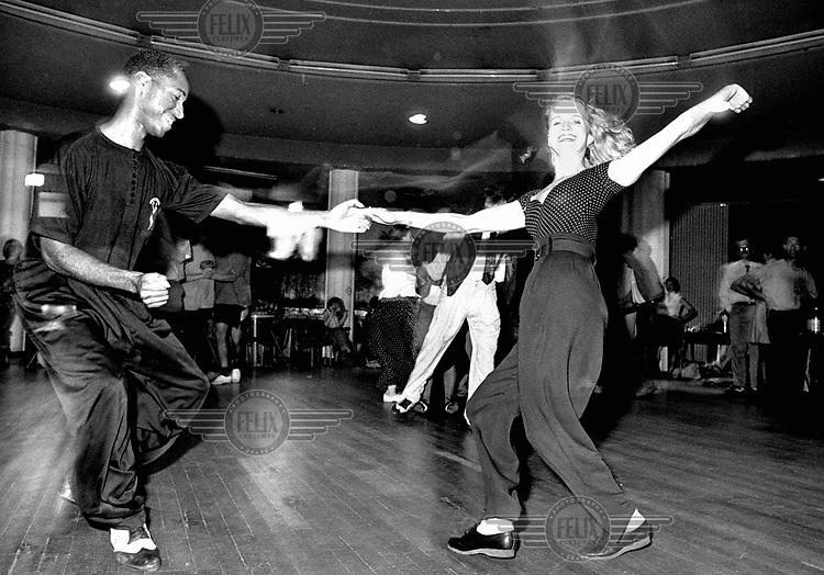 © Melanie Friend / Panos Pictures..London. Dancers 'Lindy Hop' and 'Jump Jin' at Jitterbugs club, Notre Dame Hall, Leicester Place.