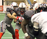 SIOUX FALLS, SD - MAY 18:  Andre Crenshaw #13 looks for room as he takes the takes the handoff from quarterback Terrance Bryant #15 from the Sioux Falls Storm against the Chicago Slaughter in the first half of their game Saturday night at the Sioux Falls Arena.  (Photo by Dave Eggen/Inertia)