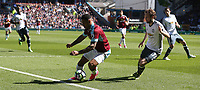 Burnley's Andre Gray shields the ball from Manchester United's Daley Blind<br /> <br /> Photographer Stephen White/CameraSport<br /> <br /> The Premier League - Burnley v Manchester United - Sunday 23rd April 2017 - Turf Moor - Burnley<br /> <br /> World Copyright &copy; 2017 CameraSport. All rights reserved. 43 Linden Ave. Countesthorpe. Leicester. England. LE8 5PG - Tel: +44 (0) 116 277 4147 - admin@camerasport.com - www.camerasport.com