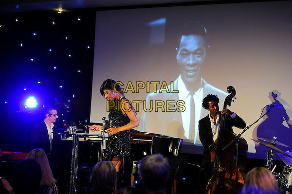 LONDON, ENGLAND - May 13: Natalie Cole performing at the UK Premiere of 'Nat King Cole. Afraid of The Dark' at The May Fair Hotel on May 13, 2014 in London, England.<br /> CAP/MAR<br /> &copy; Martin Harris/Capital Pictures