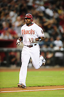 Jul. 20, 2010; Phoenix, AZ, USA; Arizona Diamondbacks outfielder Justin Upton rounds the bases after hitting a solo home run in the third inning against the New York Mets at Chase Field. Mandatory Credit: Mark J. Rebilas-