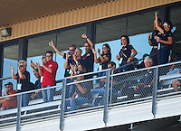 Sep 3, 2016; Clermont, IN, USA; Papa Johns pizza founder John Schnatter (red shirt) cheers during NHRA qualifying for the US Nationals at Lucas Oil Raceway. Mandatory Credit: Mark J. Rebilas-USA TODAY Sports