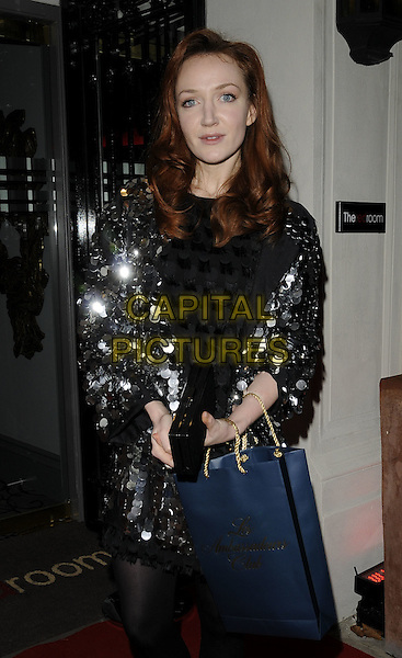 OLIVIA GRANT.The Red Room Launch Party at Les Ambassadeurs Club, Mayfair, London, England..November 2nd 2009.half length black silver sequined sequin dress coat jacket blue bag discs paillettes .CAP/CAN.©Can Nguyen/Capital Pictures.
