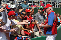 Philadelphia Phillies manager Charlie Manuel signs autographs before a scrimmage against the Florida State Seminoles at Brighthouse Field on February 29, 2012 in Clearwater, Florida.  Philadelphia defeated Florida State 6-1.  (Mike Janes/Four Seam Images)