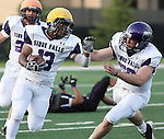 SIOUX FALLS, SD - APRIL 28: Michael Lindsey #13 of the University of Sioux Falls looks to shake the defender of Chris Harris on a punt return during the Cougars spring scrimmage Saturday evening at Bob Young Field. (Photo by Dave Eggen/Inertia)