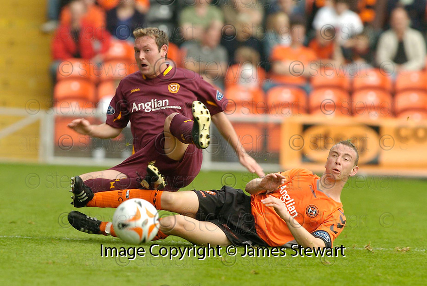 23/09/2006       Copyright Pic: James Stewart.File Name :sct_jspa11_dundee_utd_v_motherwell.STEVEN MCGARRY IS TACKLED BY DAVID PROCTOR......Payments to :.James Stewart Photo Agency 19 Carronlea Drive, Falkirk. FK2 8DN      Vat Reg No. 607 6932 25.Office     : +44 (0)1324 570906     .Mobile   : +44 (0)7721 416997.Fax         : +44 (0)1324 570906.E-mail  :  jim@jspa.co.uk.If you require further information then contact Jim Stewart on any of the numbers above.........