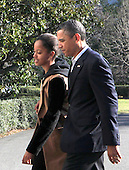 United States President Obama walks with daughter Malia as the First Family returns to White House from their Hawaiian Vacation on Sunday, January 6, 2013. .Credit: Dennis Brack / Pool via CNP