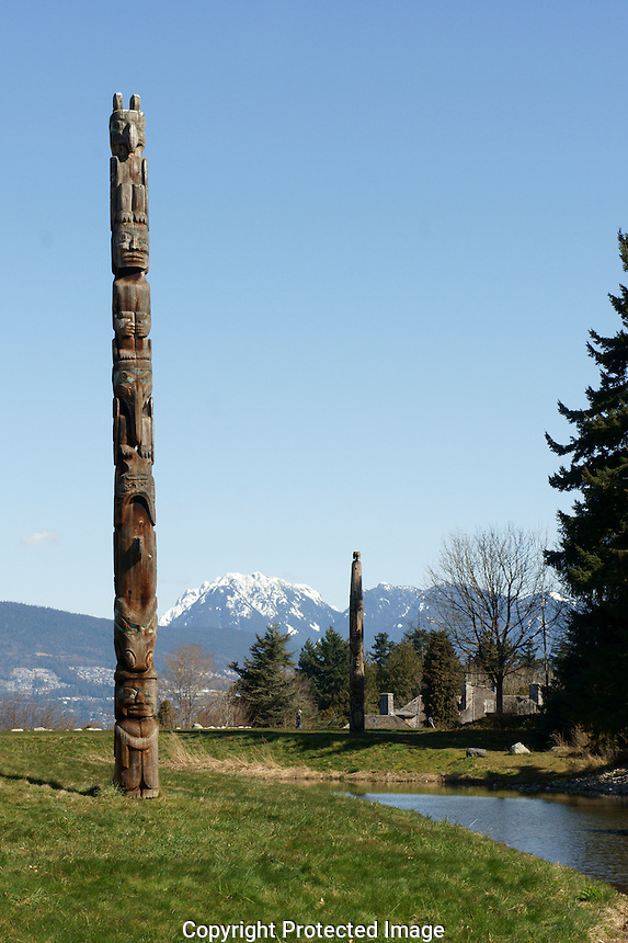 Haida Indian totem pole with mountains in background, Museum of Anthropology, University of British Columbia, Vancouver, Canada.