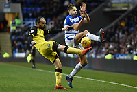 David Edwards of Reading challenges John Brayford of Burton Albion during the Sky Bet Championship match between Reading and Burton Albion at the Madejski Stadium, Reading, England on 23 December 2017. Photo by Paul Paxford.