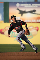 Javier Guerra (13) of the Lake Elsinore Storm chases a fly ball during a game against the Lancaster JetHawks at The Hanger on June 12, 2017 in Lancaster, California. Lancaster defeated Lake Elsinore, 13-6. (Larry Goren/Four Seam Images)