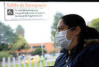 """BOGOTA, COLOMBIA - March 13:  A woman wears a face mask as waits for public transportation """"Transmilenio"""" on March 13, 2020 in Bogota, Colombia. The World Health Organization declared a global pandemic as the coronavirus rapidly spreads across the world. Colombian President Ivan Duque declared a health emergency to contain an outbreak of coronavirus, suspending public events with more than 500 people. (Photo by John W. Vizcaino/VIEWpress)"""