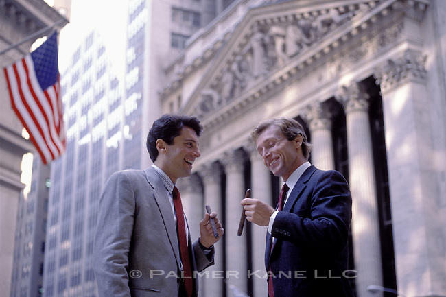 two capitalists celebrate with big cigars across from New York Stock exchange