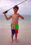 Boy with small fish on Sanibel Island