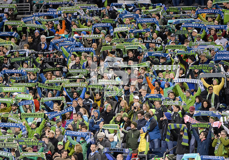 November, 2013: CenturyLink Field, Seattle, Washington: SS fans hold up scarves  as the Portland Timbers defeat  the Seattle Sounders FC 2-1 in the Major League Soccer Playoffs semifinals Round.