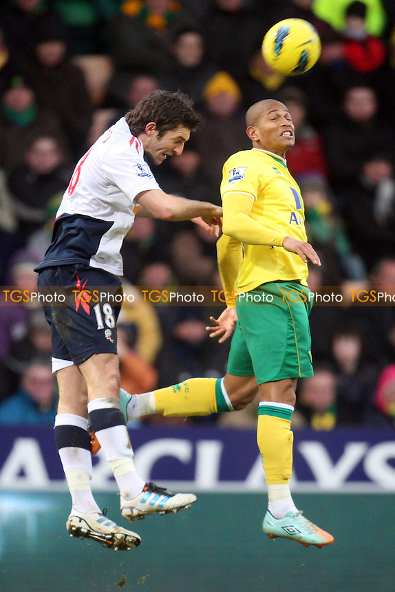 Simeon Jackson of Norwich City and Sam Ricketts of Bolton -  Norwich vs Bolton - at the Carrow Road Stadium - 04/02/12 - MANDATORY CREDIT: Dave Simpson/TGSPHOTO - Self billing applies where appropriate - 0845 094 6026 - contact@tgsphoto.co.uk - NO UNPAID USE.