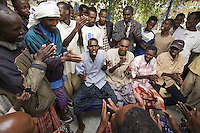 Somaliland. Awdal province. Borama. Tubeculosis (TB) hospital. A group of black muslin men sing the traditional song, Helem ( also called Jilible). The Global Fund through the ngo ( non-governmental organization ) World Vision supports the hospital with a Tuberculosis grant (financial aid). Somaliland is an unrecognized de facto sovereign state located in the Horn of Africa.  © 2006 Didier Ruef