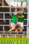Johnny Buckley Kerry and Sean Finn Limerick compete for the dropping ball during their Munster cup clash  in the Gaelic Grounds on Sunday