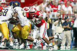 University of Wisconsin defensive lineman (92) Jonathan Welsh tackles West Virginia University wide receiver (20) Cassel Smith at Camp Randall Stadium in Madison, WI, on 9/7/02. The Badgers beat West Virginia 34-17.  (Photo by David Stluka)