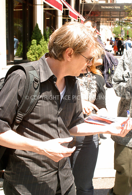 WWW.ACEPIXS.COM . . . . .  ....NEW YORK, JULY 11, 2005....Steve Buscemi takes a moment to sign autographs for fans outside his midtown hotel.....Please byline: PAUL CUNNINGHAM - ACE PICTURES..... *** ***..Ace Pictures, Inc:  ..Craig Ashby (212) 243-8787..e-mail: picturedesk@acepixs.com..web: http://www.acepixs.com