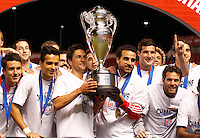 Players of D.C. United celebrate their win with the trophy over Real Salt Lake at the U.S. Open Cup Final on October 1, 2013 at Rio Tinto Stadium in Sandy, Utah. DC United beat Real Salt Lake 1-0 to win the championship.