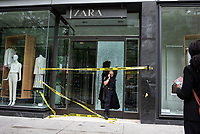 NEW YORK, NEW YORK - JUNE 2: A Police officer leaves from a Zara store after a night of looting due to protest on June 2, 2020 in New York City. Protests spread across the country in at least 30 cities across the United States, over the death of unarmed black man George Floyd at the hands of a police officer, this is the latest death in a series of police deaths of black Americans. New York face it's second night of a curfew (Photo by Joana Toro / VIEWpress via Getty Images)