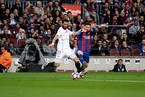April 5th 2017, Nou Camp, Barcelona, Spain, Spanish La Liga football, FC Barcelona versus Espanyol;   Messi jumps in to block the attempted clearance from Pareja