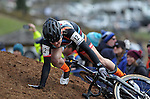 January 10, 2016 - Asheville, North Carolina, U.S. -  Sram/Strave cyclist, Elle Anderson, takes a fall on a steep off camber pitch during the USA Cycling Cyclo-Cross National Championships at the historic Biltmore Estate, Asheville, North Carolina.
